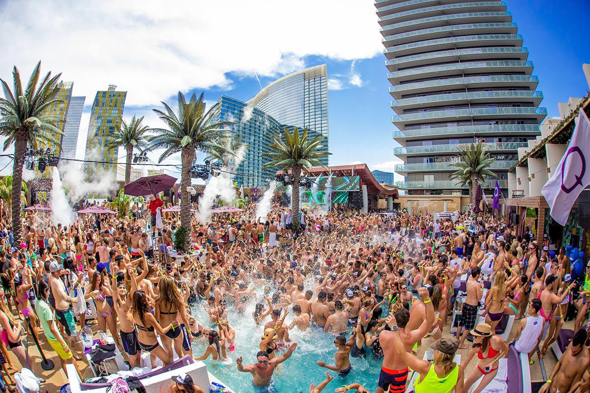 students partying at a massive spring break pool party